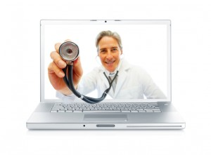 Digital composite - Happy senior doctor holding a stethoscope through a laptop screen